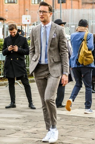 How To Wear a Dress Shirt With a Suit: This pairing of a suit and a dress shirt comes in handy when you need to look like a maverick in the menswear department. And it's amazing how a pair of white low top sneakers can shake up a look.