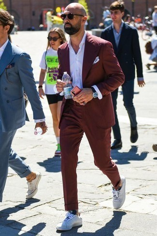 How to Wear a White Dress Shirt For Men: Consider teaming a white dress shirt with a burgundy suit for seriously dapper attire. For something more on the casual side to round off your look, complete this ensemble with white and black canvas low top sneakers.