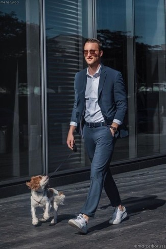 How to Wear a Dark Brown Leather Watch For Men: If you don't take fashion too seriously, go for a casual outfit in a navy suit and a dark brown leather watch. Introduce white leather low top sneakers to the mix and you're all done and looking awesome.