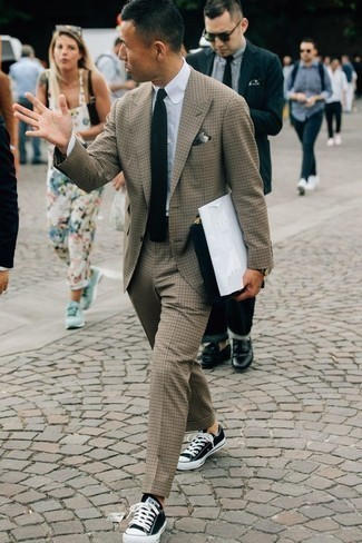 How to Wear a Navy Knit Tie For Men: For an outfit that's elegant and camera-worthy, reach for a tan suit and a navy knit tie. Get a bit experimental with shoes and add a pair of black and white canvas low top sneakers to this ensemble.