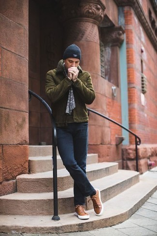 Men's Looks & Outfits: What To Wear In Winter: If the setting allows casual style, you can easily go for an olive shearling jacket and navy jeans. Rounding off with a pair of brown leather low top sneakers is a fail-safe way to introduce a hint of stylish casualness to your ensemble. In winter, when warmth is prized, it can be easy to settle for a less-than-stylish look. However, this look proves that you can actually stay snug and remain stylish at the same time during winter.