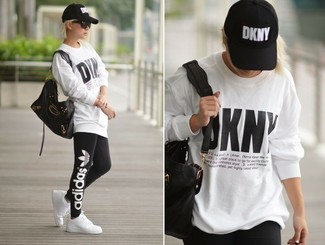 How to wear: black leather tote bag, white low top sneakers, black print leggings, white print oversized sweater