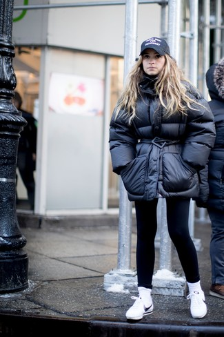 How to wear: black print cap, white leather low top sneakers, black leggings, black puffer jacket