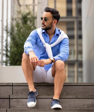 How to wear: dark green sunglasses, navy and white canvas low top sneakers, blue long sleeve shirt, white crew-neck sweater