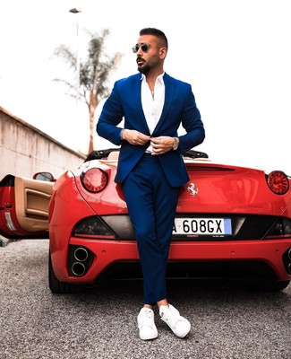 How to wear: black sunglasses, white leather low top sneakers, white long sleeve shirt, blue suit