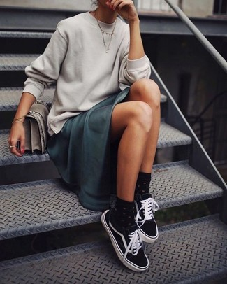How to wear: grey leather satchel bag, black and white canvas low top sneakers, teal satin maxi dress, grey sweatshirt