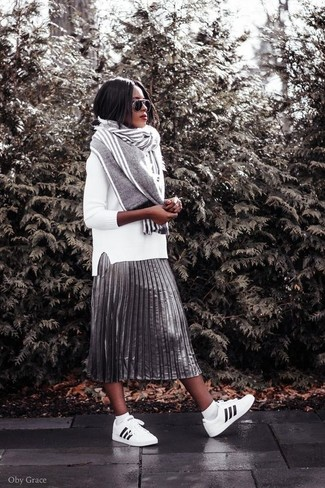 How to wear: grey vertical striped scarf, white and black leather low top sneakers, silver pleated midi skirt, white crew-neck sweater