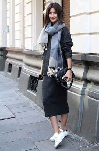 How to wear: black quilted leather crossbody bag, white and black low top sneakers, charcoal midi skirt, charcoal oversized sweater