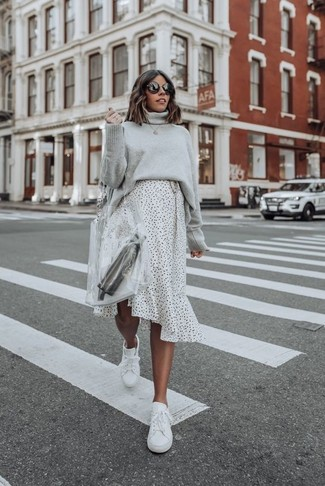 How to wear: clear rubber tote bag, white leather low top sneakers, white and black polka dot midi skirt, grey knit turtleneck