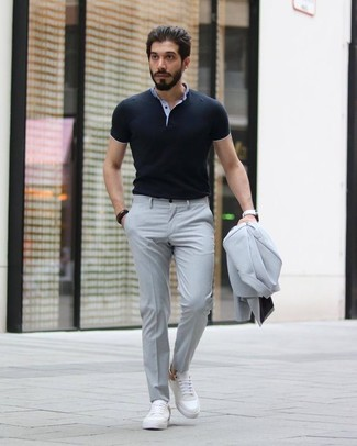 How to wear: white leather watch, white leather low top sneakers, black polo, grey suit