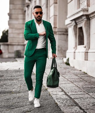 How to Wear a Green Suit: This combo of a green suit and a white polo is really a statement-maker. Why not take a more laid-back approach with shoes and throw a pair of white leather low top sneakers into the mix?