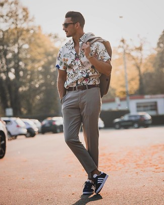 How to wear: dark brown leather belt, navy and white low top sneakers, white floral short sleeve shirt, grey suit
