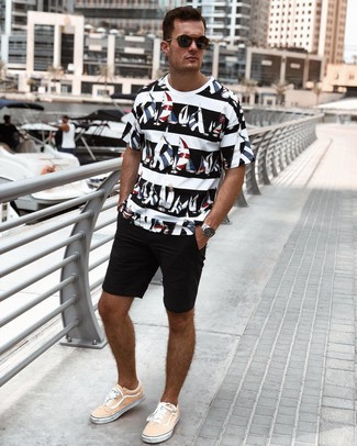 How to wear: black sunglasses, orange canvas low top sneakers, black shorts, white and black print crew-neck t-shirt