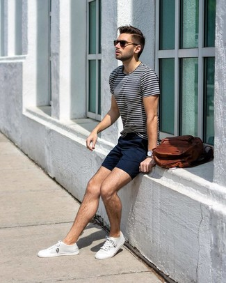 How to wear: brown leather backpack, white canvas low top sneakers, navy shorts, white and navy horizontal striped crew-neck t-shirt