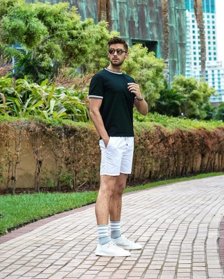 How to wear: olive sunglasses, white leather low top sneakers, white shorts, dark green crew-neck t-shirt