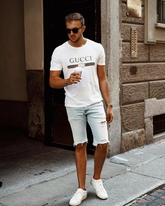 How to wear: black sunglasses, white leather low top sneakers, light blue ripped denim shorts, white print crew-neck t-shirt