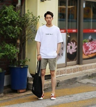 How to Wear a Black Canvas Tote Bag For Men: A white and black print crew-neck t-shirt and a black canvas tote bag are a nice outfit to integrate into your current casual lineup. And if you wish to effortlessly lift up this outfit with a pair of shoes, why not introduce red canvas low top sneakers to your outfit?
