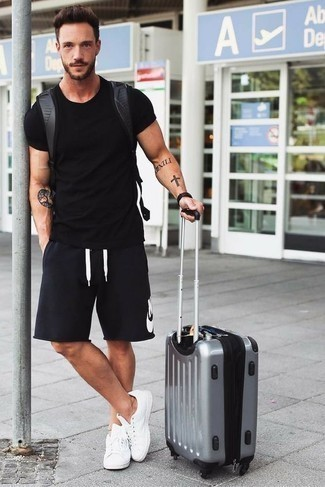 How to Wear a Black Leather Backpack For Men: Choose a black crew-neck t-shirt and a black leather backpack for a casual level of dress. If you feel like playing it up, complete your outfit with white canvas low top sneakers.