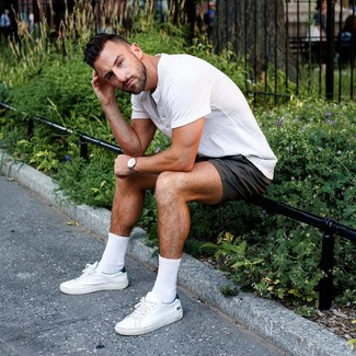 How to wear: grey leather watch, white leather low top sneakers, black shorts, white henley shirt