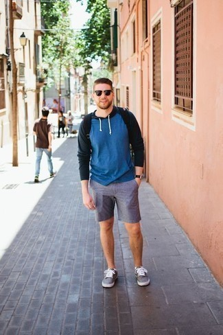 Men's Looks & Outfits: What To Wear Casually: If you're a fan of casual looks, why not wear this pairing of a blue hoodie and blue shorts? If in doubt as to what to wear in the shoe department, go with a pair of grey canvas low top sneakers.