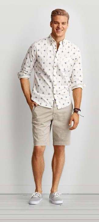 How to wear: dark brown leather watch, grey canvas low top sneakers, beige shorts, white print long sleeve shirt