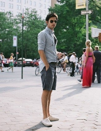 Men's Looks & Outfits: What To Wear In 2020: For a laid-back look, consider wearing a light blue long sleeve shirt and navy shorts — these two pieces work nicely together. Now all you need is a pair of white canvas low top sneakers.