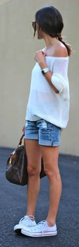 How to wear: dark brown print leather duffle bag, white low top sneakers, blue denim shorts, white oversized sweater