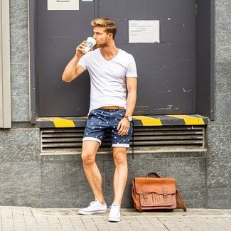 How to wear: tan leather messenger bag, white canvas low top sneakers, navy print shorts, white v-neck t-shirt