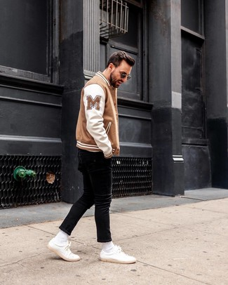 How to wear: black sunglasses, white leather low top sneakers, black skinny jeans, white and brown bomber jacket