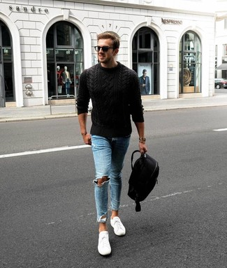 How to wear: black backpack, white low top sneakers, light blue ripped skinny jeans, black cable sweater