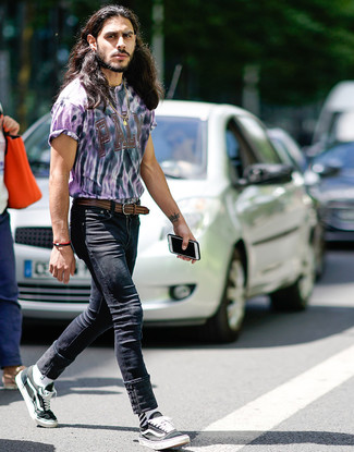 How to wear: brown woven leather belt, black and white canvas low top sneakers, black skinny jeans, light violet tie-dye crew-neck t-shirt