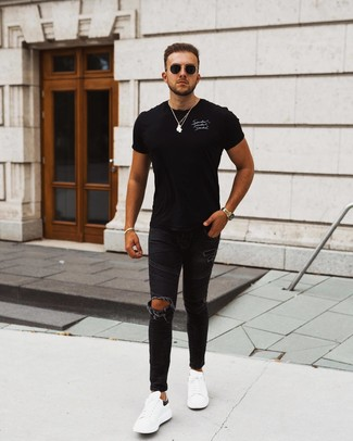 How to wear: black sunglasses, white and black leather low top sneakers, black ripped skinny jeans, black and white print crew-neck t-shirt