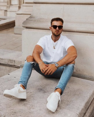 How to wear: black sunglasses, white leather low top sneakers, blue ripped skinny jeans, white crew-neck t-shirt