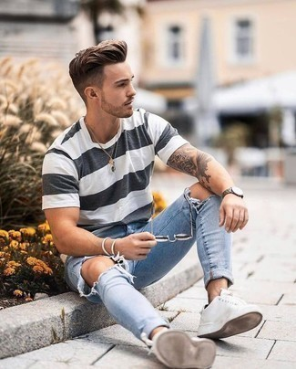 How to Wear a White and Black Horizontal Striped Crew-neck T-shirt For Men: This combo of a white and black horizontal striped crew-neck t-shirt and light blue ripped skinny jeans brings comfort and efficiency and helps keep it clean yet contemporary. For something more on the smart end to complement your getup, complete this getup with a pair of white canvas low top sneakers.