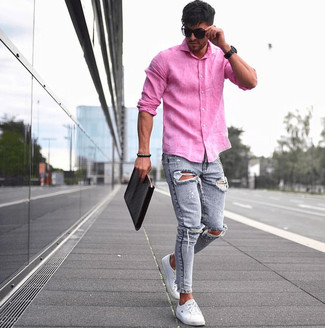 How to wear: black leather zip pouch, white low top sneakers, light blue ripped skinny jeans, hot pink linen long sleeve shirt