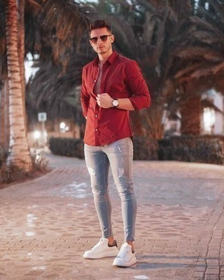 How to Wear Burgundy Sunglasses For Men: If you feel more confident wearing something functional, you'll appreciate this off-duty pairing of a red long sleeve shirt and burgundy sunglasses. White and black leather low top sneakers will infuse a dose of refinement into an otherwise utilitarian ensemble.