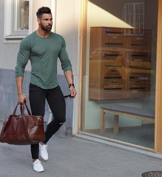How to wear: dark brown leather holdall, white leather low top sneakers, black ripped skinny jeans, olive long sleeve t-shirt