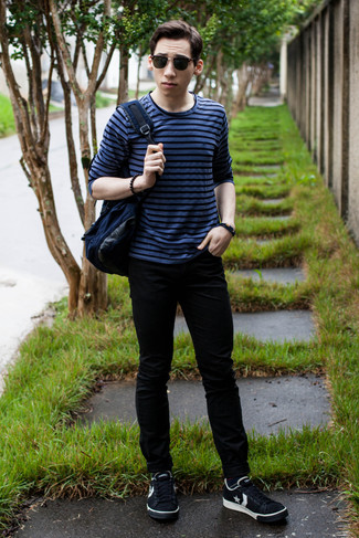 How to wear: navy canvas backpack, black and white star print low top sneakers, black skinny jeans, blue horizontal striped long sleeve t-shirt