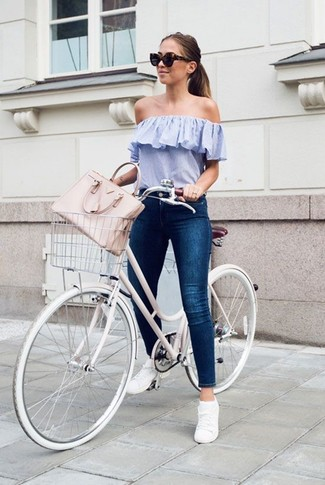 How to wear: pink leather tote bag, white low top sneakers, navy skinny jeans, light blue off shoulder top