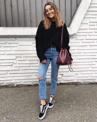 How to wear: burgundy leather bucket bag, black suede low top sneakers, light blue ripped skinny jeans, black oversized sweater