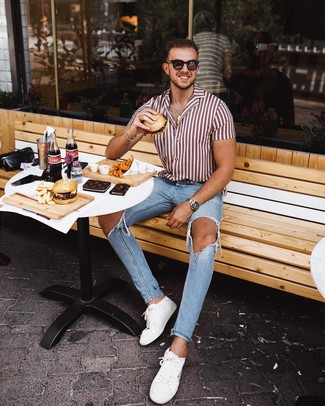 How to wear: dark brown sunglasses, white leather low top sneakers, light blue ripped skinny jeans, white and red vertical striped short sleeve shirt