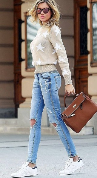 How to wear: brown leather satchel bag, white leather low top sneakers, light blue ripped skinny jeans, beige star print turtleneck