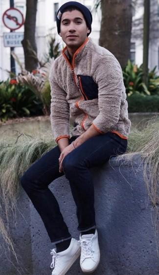 How to wear: black beanie, white leather low top sneakers, navy skinny jeans, beige fleece zip sweater