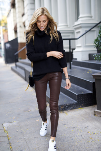 How to wear: black suede crossbody bag, white leather low top sneakers, dark brown leather skinny pants, black turtleneck