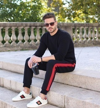 How to Wear White Print Leather Low Top Sneakers For Men: A black crew-neck sweater and black sweatpants worn together are a match made in heaven for gentlemen who appreciate casual and cool styles. Now all you need is a pair of white print leather low top sneakers.