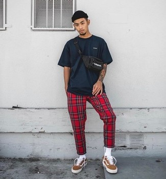 How to wear: black beanie, tobacco suede low top sneakers, red plaid sweatpants, navy crew-neck t-shirt