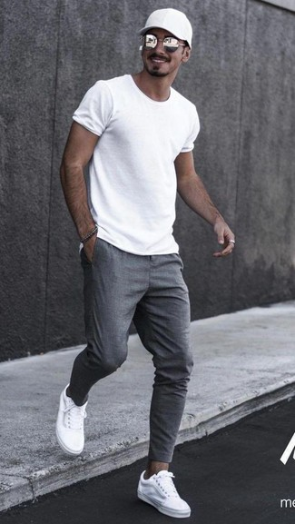 How to wear: black baseball cap, white canvas low top sneakers, grey sweatpants, white crew-neck t-shirt