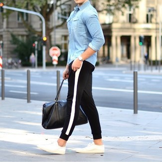 How to wear: black leather holdall, white low top sneakers, black and white sweatpants, light blue denim shirt