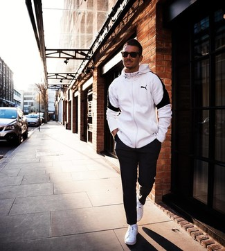 How to wear: dark brown sunglasses, white low top sneakers, black sweatpants, white and black hoodie