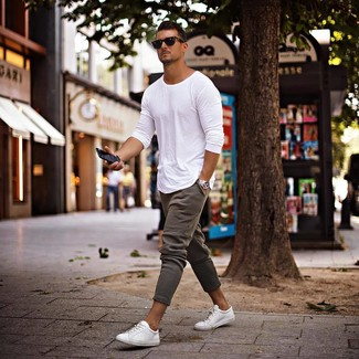 How to wear: black sunglasses, white low top sneakers, grey sweatpants, white long sleeve t-shirt